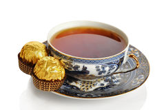 Cup of tea with sweets. Isolated on a white background Royalty Free Stock Photo