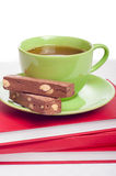 Cup of tea and sweets on books stack. Concept of reading, studyi Royalty Free Stock Photography