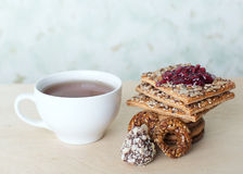 Cup of tea and sweets Stock Photos