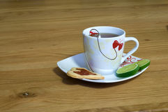Cup of tea on the table. Cup of tea with cookie on the table Stock Photo