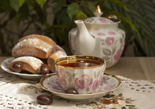A cup of tea on the table. A cup of tea and tea and Cake on the table Royalty Free Stock Photo