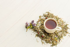 Cup of tea on table with herbs Royalty Free Stock Photo