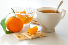 Cup of tea and tangerine Royalty Free Stock Image