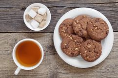 Tea and tasty chocolate cookies Stock Photos