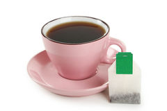 Cup of tea with tea bag isolated on white background Royalty Free Stock Photos
