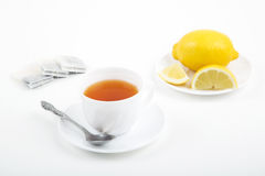 Cup of tea with tea-bag and lemon. On a white background stock photos