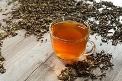 Cup of tea in tea leaves Royalty Free Stock Photos