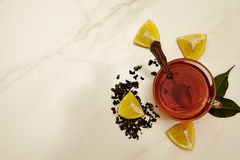 Cup of tea, tea, lemon, tea leaves Royalty Free Stock Photos