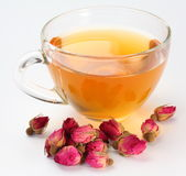 Cup of tea and tea roses. Stock Photo
