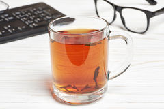 Cup of tea and tea-strainer Stock Images