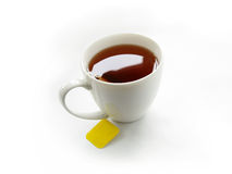Cup of tea with teabag. Cup of tea on a white background Royalty Free Stock Image