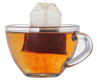 Cup of tea with teabag. Glass cup of black tea with teabag Royalty Free Stock Image