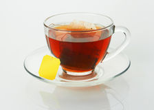 Cup with tea and teabag stock photos