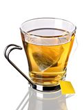 Cup of tea with teabag (clipping path). Cup of tea with pyramid teabag on white background. Clipping path included Royalty Free Stock Photo