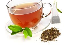 Cup of tea with teabag. Isolated on white Stock Images