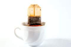 Cup of tea with teabag pull out Stock Photos