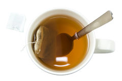 Cup of tea with a teabag and a spoon viewed from above Royalty Free Stock Photos