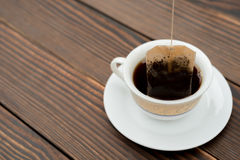 Cup of tea with teabag on wood Royalty Free Stock Image