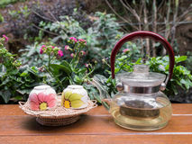 Cup of tea and teakettle at garden, Chiangmai, Thailand. Cup of tea and teakettle on bar at garden, Chiangmai, Thailand stock photo