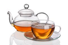 Cup of tea with teapot. On white background stock photos
