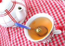 A cup of tea and a teapot Royalty Free Stock Photography