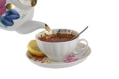 Cup of tea with teapot Stock Photography