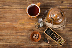 Cup of tea with teapot, above view. Royalty Free Stock Photo