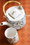 A cup of tea with teapot in the background. Phetchaboon thailand Royalty Free Stock Images