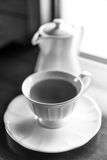 Cup of tea with teapot, black and white Stock Photos