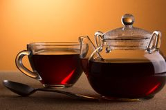 Cup with tea and teapot Royalty Free Stock Photography