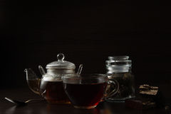 Cup with tea and teapot Stock Image
