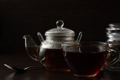 Cup with tea and teapot Royalty Free Stock Images
