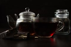 Cup with tea and teapot Royalty Free Stock Image