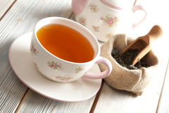Cup of tea, teapot and dried leaves of tea Stock Photo