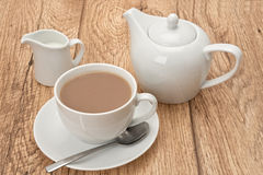 Cup of tea and a teapot Stock Images