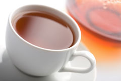 Cup of tea and teapot isolated Stock Photos
