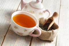 Cup of tea and teapot and leaves of tea Royalty Free Stock Photo