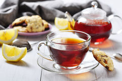 Cup of tea with teapot. Lemon and cookies on wooden background Royalty Free Stock Photo