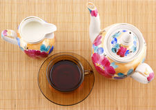 Cup of tea with teapot and milk jug Stock Photo