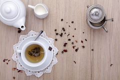 Cup of tea with teapot, milk, sugar, on wooden Royalty Free Stock Photos