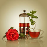 Cup of tea, teapot with mint leaf Stock Photography