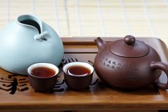 Cup of tea with teapot and porcelain vase Royalty Free Stock Image