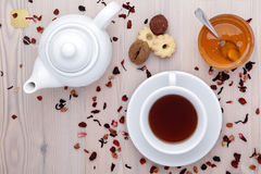 Cup of tea and teapot with spices, buiscuits and honey Stock Images