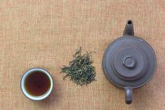 Cup with tea and teapot, loose tea stock image
