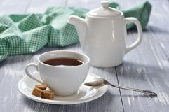 Cup of tea. And teapot on wooden background Stock Images
