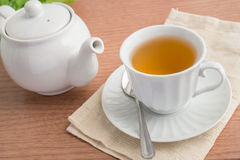 A cup of  tea and a teapot Stock Photos