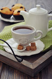 Cup of tea. And teapot on wooden tray closeup Royalty Free Stock Image