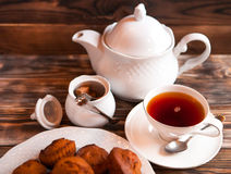 Cup of tea and teapot on wooden tray closeup Royalty Free Stock Photo