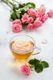 Cup of tea and tender pink roses on a white background.  Stock Photography