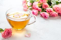 Cup of tea and tender pink roses on a white background copy spac. E Stock Images